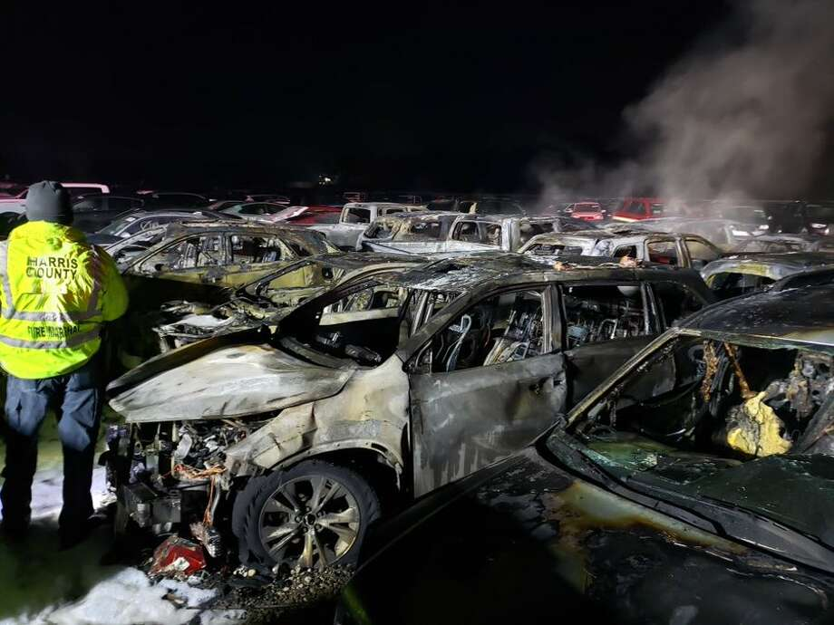 An overnight fire at the Cash For Cars lot near the Bush International Airport burned more than two dozen vehicles, officials said. An electrical anomaly caused the fire to start in one car in the Rankin Road lot, and it quickly spread to 26 others, according to the Harris County Fire Marshal's Office. Photo: OnScene TV