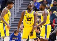 From left: Golden State Warriors Marquese Chriss (32), Draymond Green (23) and Eric Paschall (7) in the second period of an NBA game against the Boston Celtics at Chase Center on Friday, Nov. 15, 2019, in San Francisco, Calif.