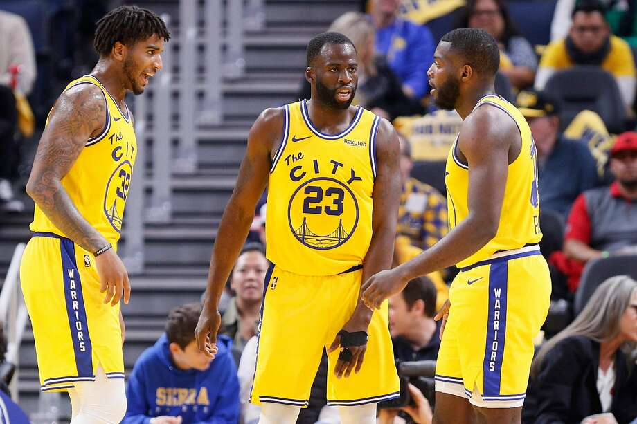 From left: Golden State Warriors Marquese Chriss (32), Draymond Green (23) and Eric Paschall (7) in the second period of an NBA game against the Boston Celtics at Chase Center on Friday, Nov. 15, 2019, in San Francisco, Calif. Photo: Santiago Mejia / The Chronicle