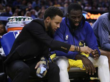 Golden State Warriors' Stephen Curry, left, points to the fingers of teammate Draymond Green during the first half of an NBA basketball game against the Boston Celtics, Friday, Nov. 15, 2019, in San Francisco. (AP Photo/Ben Margot) Photo: Ben Margot / Associated Press