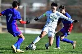 Shenendehowa's Rhys Hourmont, center, clears the ball between Fairport's Jude Rouhana, left, and Fairport's C.J. Brunken during a NYSPHSAA Boys Soccer Championships Class AA semifinal in Middletown, N.Y., Saturday, Nov. 16, 2019. Shenendehowa's season ended with a 1-0 loss in double overtime to Fairport-V. (Adrian Kraus / Special to the Times Union)