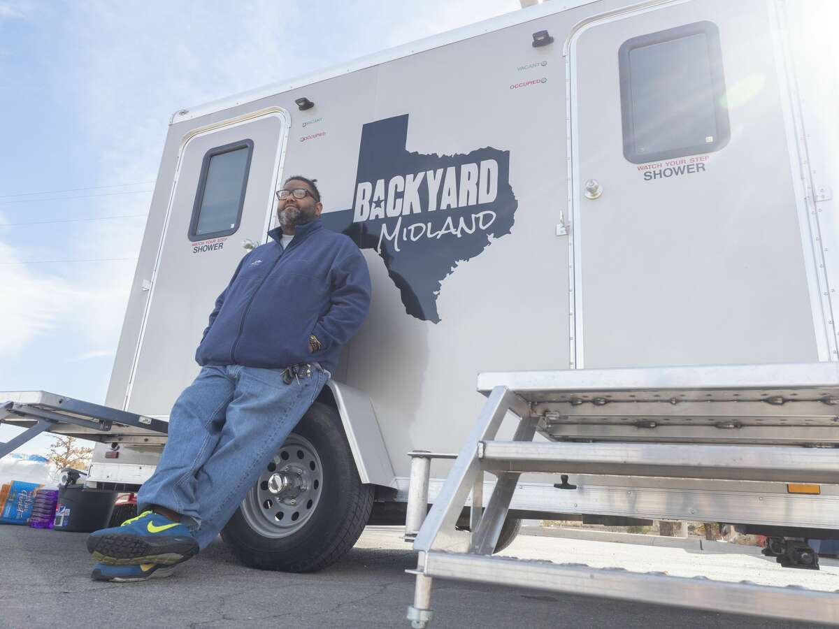 Karl Boroski, founder of Backyard Midland, shows a portable shower 11/16/19 that is taken around and allows the homeless population to have a hot shower. Tim Fischer/Reporter-Telegram