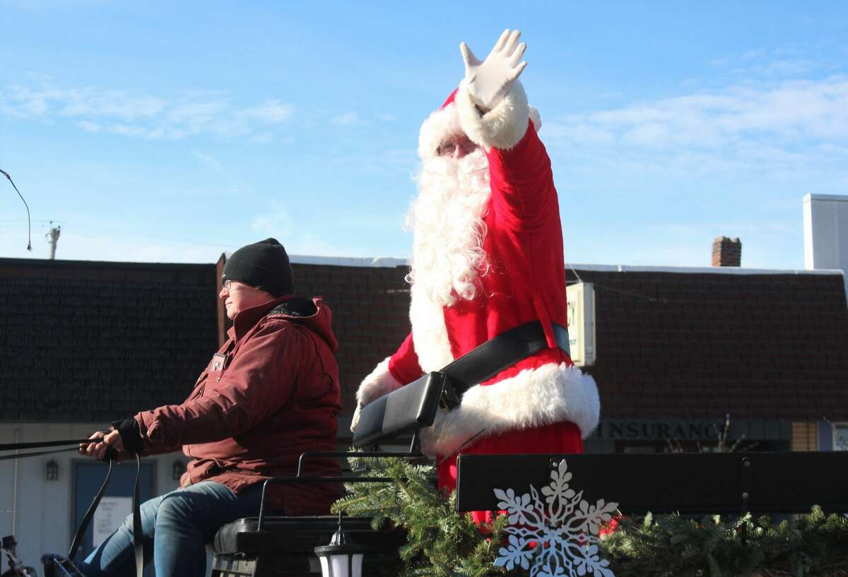 Friends and families of all ages lined Michigan Avenue in Baldwin to ring in the holiday season with the annual Santa Parade on Saturday.