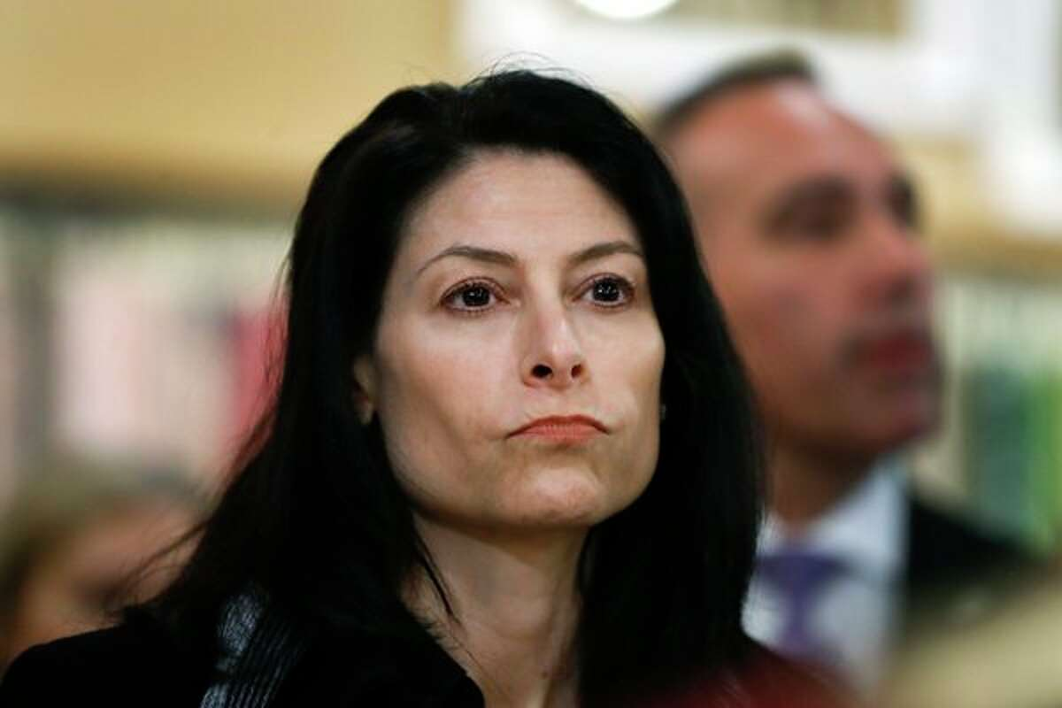 FILE - In this March 18, 2019, file photo, Michigan Attorney General Dana Nessel is seen in Clawson, Mich. Nessel plans a crackdown on illegal robocalls. On Friday, Nov. 15, 2019, she announced a dozen initiatives aimed at putting a halt to the calls, many of which she says are scams. (AP Photo/Paul Sancya File)