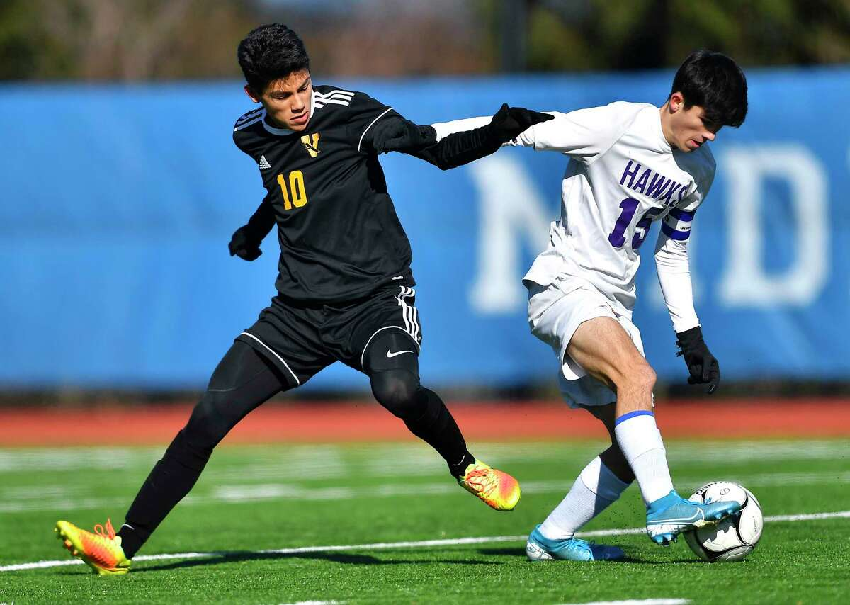 Voorheesville's Shaun Turnbull, left, is shielded off the ball by Rhinebeck's Colin Murray during a NYSPHSAA Boys Soccer Championships Class C semifinal in Middletown, N.Y., Saturday, Nov. 16, 2019. Voorheesville's season ended with a 1-0 loss to Rhinebeck-IX. (Adrian Kraus / Special to the Times Union)