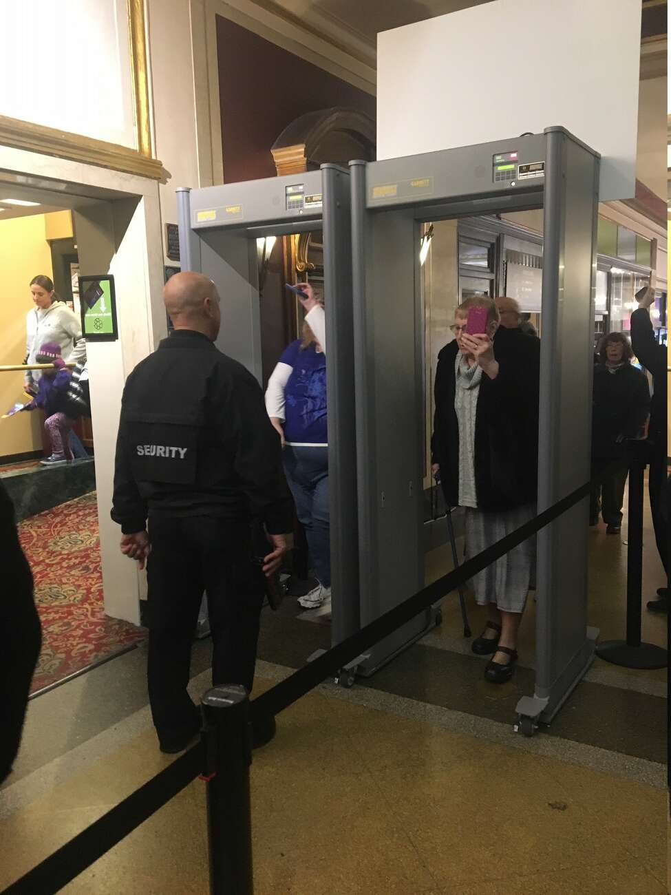 Proctors patrons walk through new security devices at the Schenectady theater.