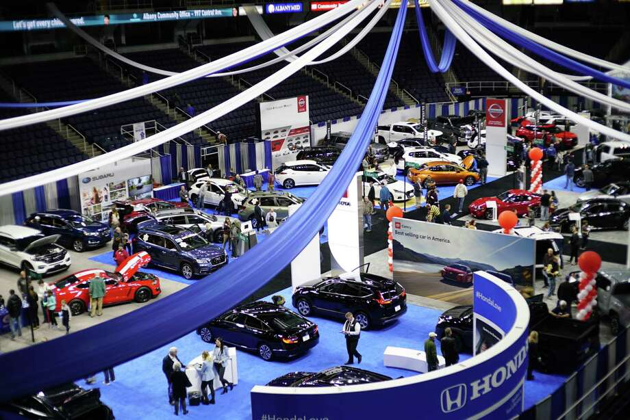 Adults and children look over the various cars on display at the Albany Auto Show at the Times Union Center on Sunday, Nov. 3, 2019, in Albany, N.Y.  Thirty manufacturers were on display at the three-day show.   (Paul Buckowski/Times Union) Photo: Paul Buckowski / (Paul Buckowski/Times Union)
