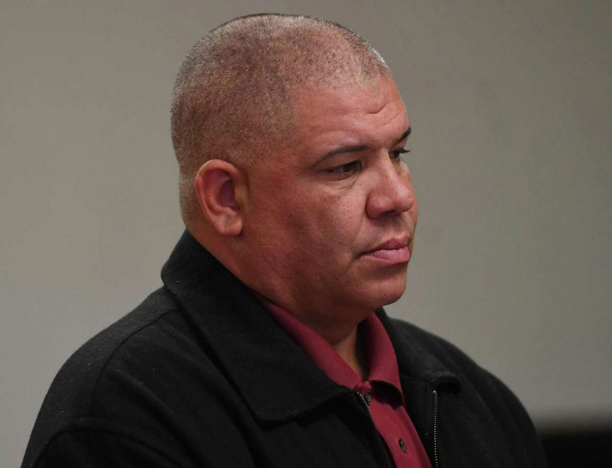 Norwalk police office Hector Delgado, 46, of Stratford, appears in state Superior Court in Bridgeport.