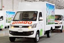 """Mexican bread maker Grupo Bimbo, a company with strong ties to the Houston area, is dabbling its toe in the electric vehicle business with plans for one of its subsidiaries to make more than 4,000 """"green"""" delivery trucks that will be used on routes south of the border."""