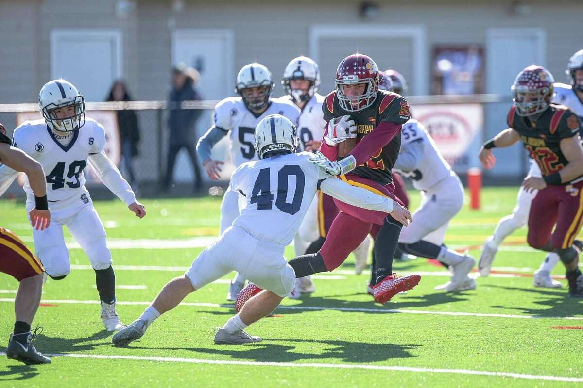 St. Joseph's William Diamantis takes the opening kickoff for a big gain against Staples on Saturday.