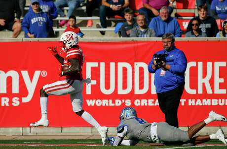 Houston Cougars wide receiver Marquez Stevenson (5) scores a 53-yard receiving touchdown against the Memphis Tigers during the first quarter of an NCAA game at TDECU Stadium Saturday, Nov. 16, 2019, in Houston.