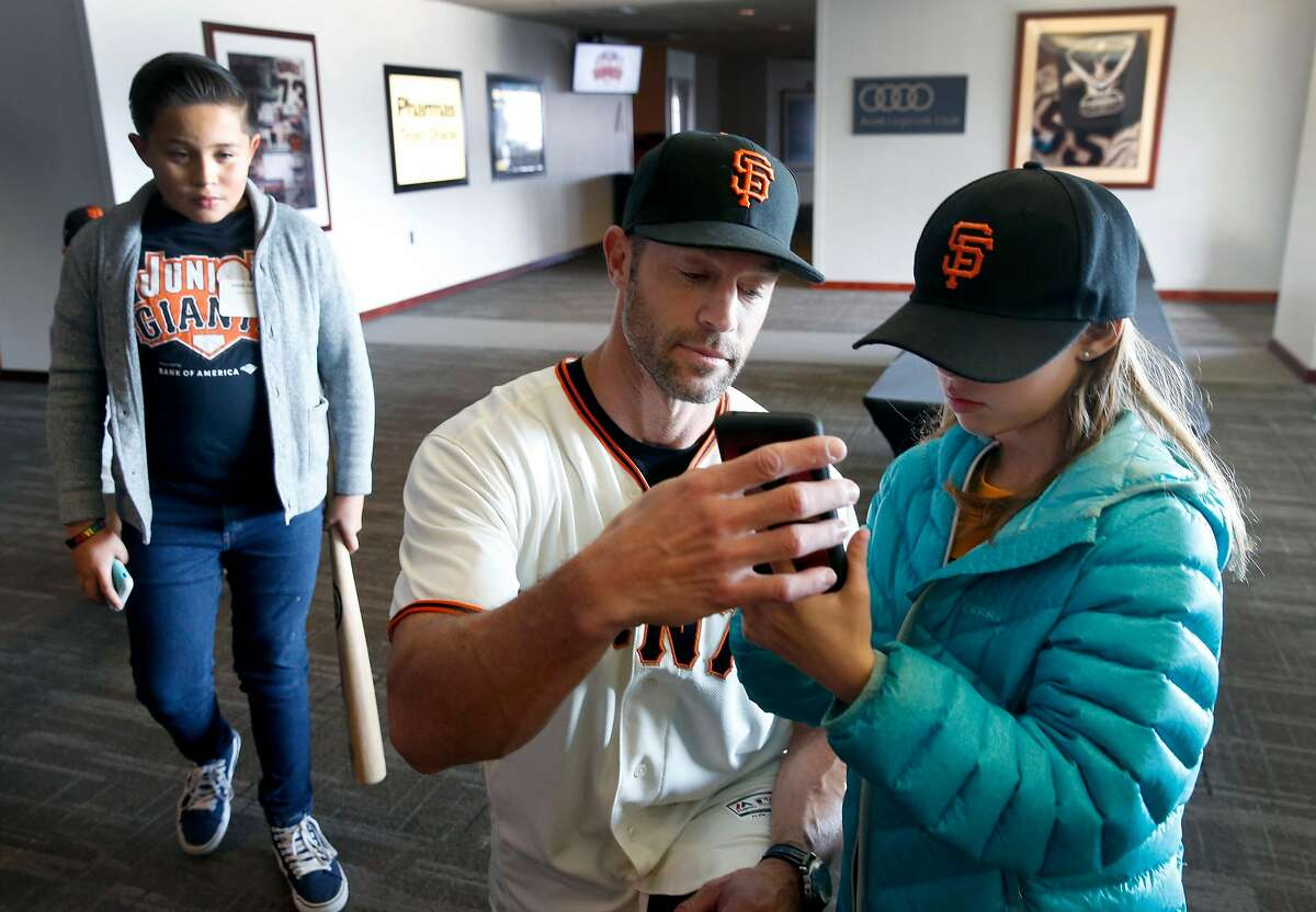 New San Francisco Giants Manager Gabe Kapler helps a young fan snap a selfie at a Willie Mac Award luncheon for the Junior Giants at Oracle Park in San Francisco, Calif. on Saturday, Nov. 16, 2019.