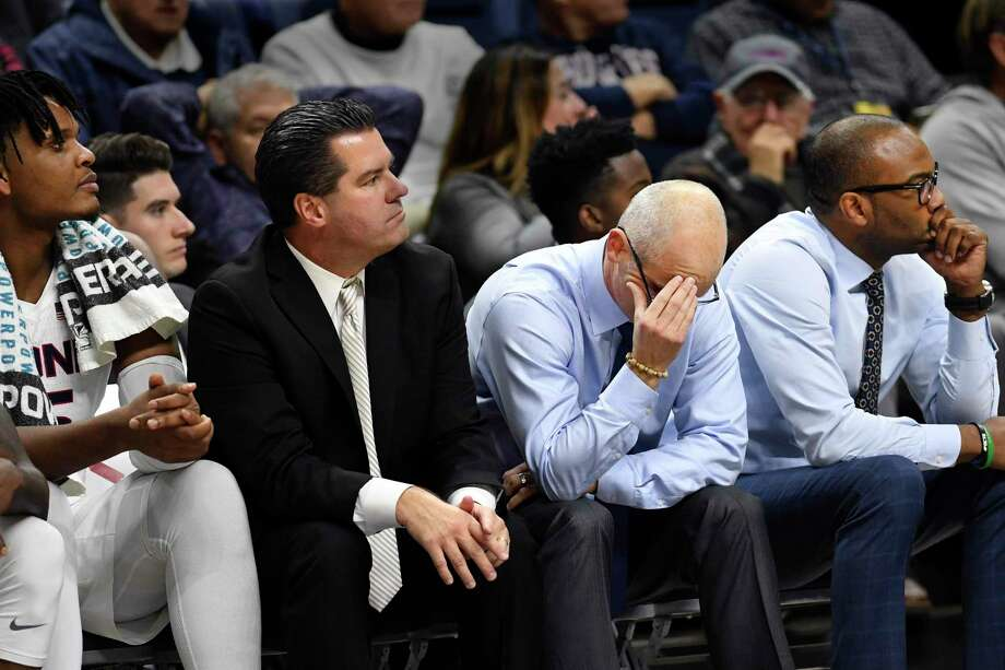 UConn head coach Dan Hurley puts his head in his hands with his team trailing in the closing minutes against St. Joseph's on Wednesday. Photo: Stephen Dunn / Associated Press / Copyright 2019 The Associated Press. All rights reserved