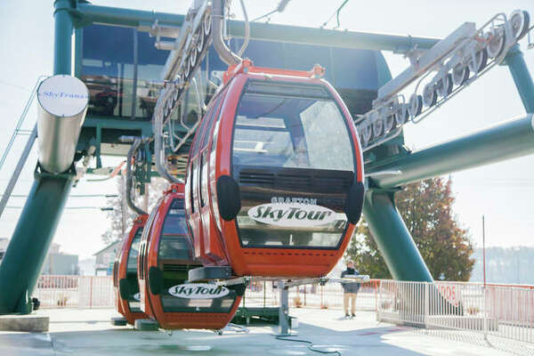 The Grafton SkyTour aerial lift is a combination of enclosed gondolas and open chair lifts. The new attraction celebrated its grand opening Friday.