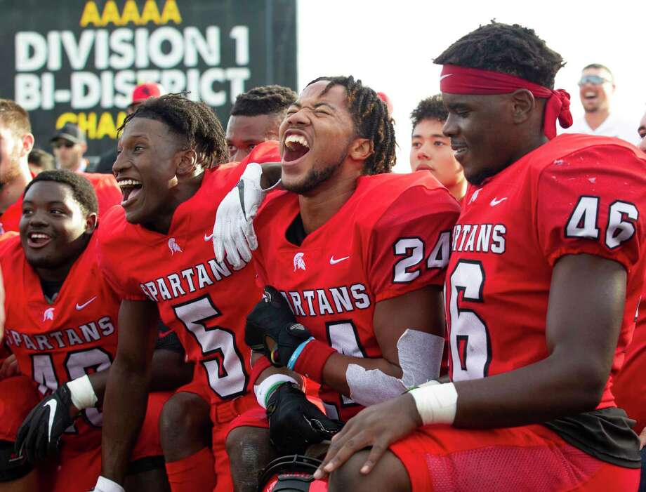 Porter wide receiver Jojo Guillory (5) reacts beside running back Matthew Williams (24) and linebacker Zhyon Bell (46) after defeating Hightower 21-17 during a Region III-5A bi-district high school football playoff game at Randall Reed Stadium, Saturday, Nov. 16, 2019, in New Caney. Photo: Jason Fochtman, Houston Chronicle / Staff Photographer / Houston Chronicle