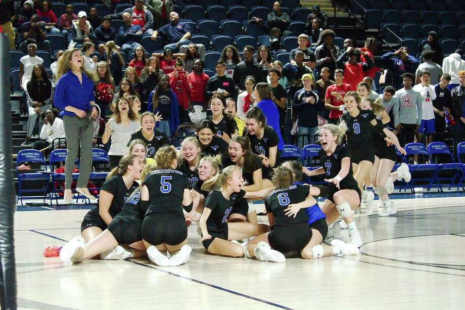 Friendswood players and coaches celebrates a four-set victory over Manvel Saturday in the Region III-5A volleyball championship match at Delmar Fieldhouse. Photo: Kirk Sides / Staff Photographer / © 2019 Kirk Sides / Houston Chronicle