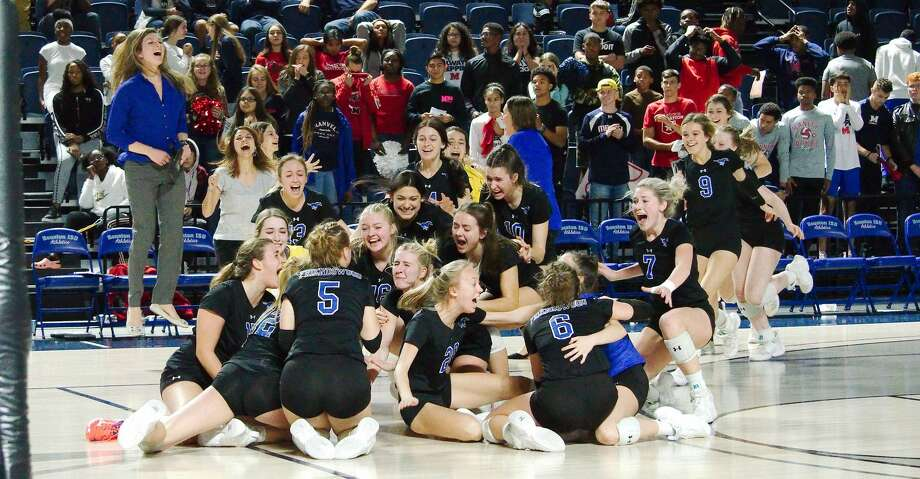 Friendswood celebrates a victory over Manvel Saturday, Nov. 16 in the regional volleyball championship game at Delmar Fieldhouse. Photo: Kirk Sides/Staff Photographer