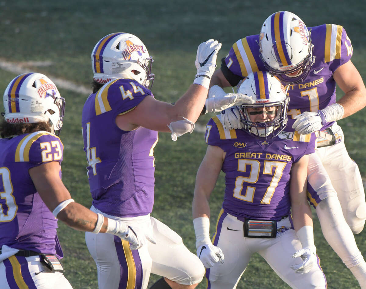 UAlbany celebrates after Hayden Specht (27) intercepted a pass at his own 3-yard line in fourth quarter of the 24-17 win over New Hampshire on Nov. 16, 2019. (Hans Pennink/Special to the Times Union)