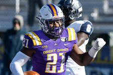 UAlbany's Karl Mofor runs for the first of his two touchdowns in the 24-17 win over New Hampshire on Nov. 16, 2019. (Hans Pennink/Special to the Times Union)
