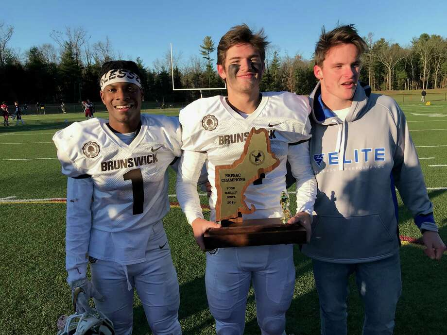 From left to right: Brunswick senior captains Kevonne Wilder, Nick Winegardner and Aengus Rosato gather around the trophy after the Bruins beat Governor's Academy, 19-12, in the NEPSAC Todd Marble Bowl at Wilbraham and Monson Academy in Wilbraham, Mass. Photo: David Fierro /Hearst Connecticut Media