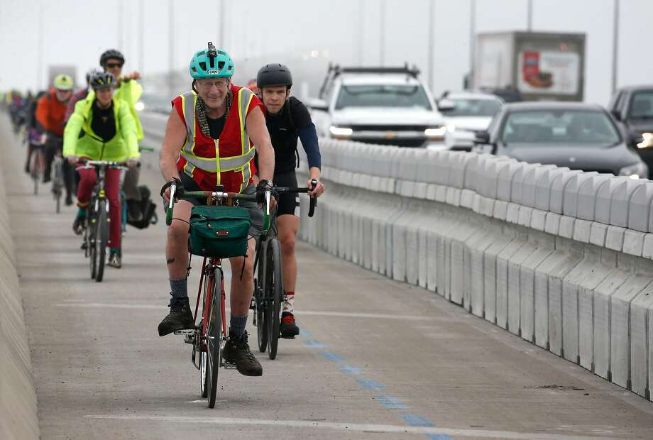 Bicyclists complete their inaugural ride across the Richmond-San Rafael Bridge after the new bike and pedestrian path on the span opened to the public. Photo: Paul Chinn / The Chronicle