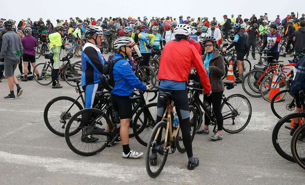 Hundreds of cyclists congregate at an official ceremony before embarking on their first ride across the Richmond-San Rafael Bridge on the new bike and pedestrian path in Richmond, Calif. on Saturday, Nov. 16, 2019.