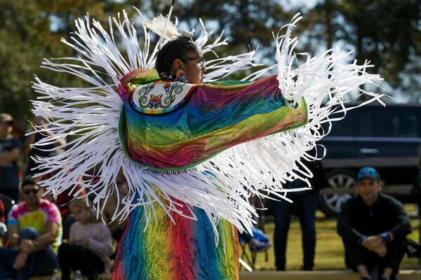 Julianne Butler performs a fancy dance, used in time of war, as members of the Alabama-Coushatta perform dances and talk about the tribe's history at the Heritage Museum of Montgomery County, Saturday, Nov. 16 2019, in Conroe.