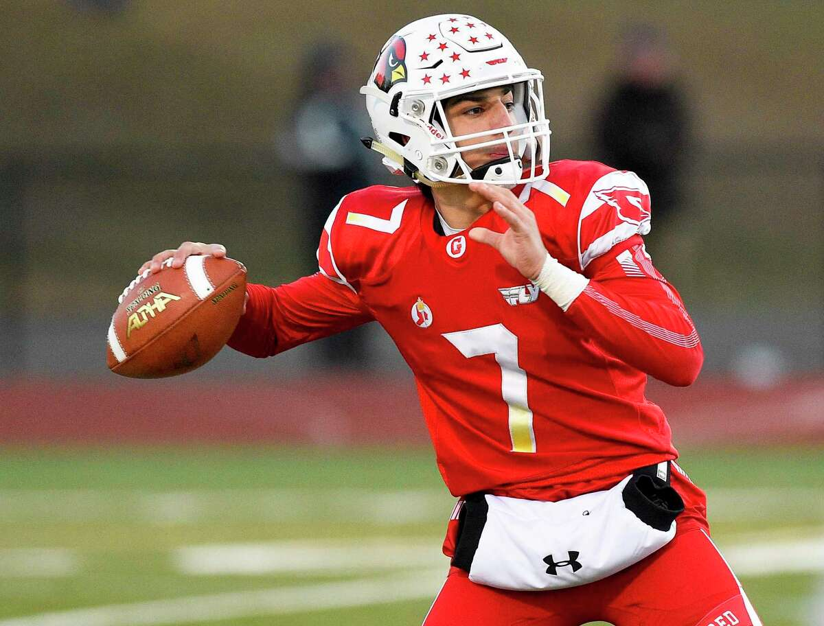 Greenwich's James Rinello passes against Ridgefield at Cardinal Stadium in Greenwich.
