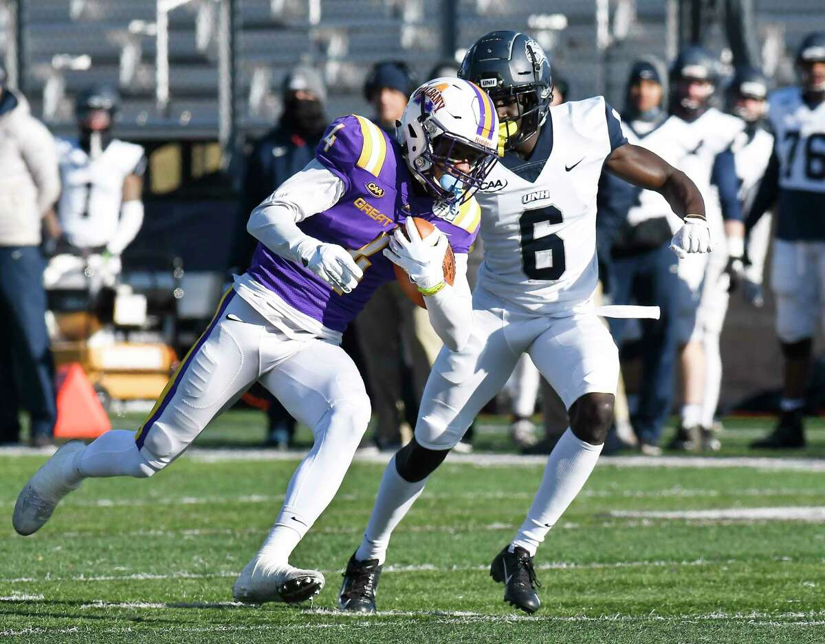 University at Albany wide receiver Juwan Green (4) is defended by New Hampshire cornerback Prince Smith Jr. (6) during the first half of an NCAA football game Saturday, Nov. 16, 2019, in Albany, N.Y. University at Albany won the game 24-17.