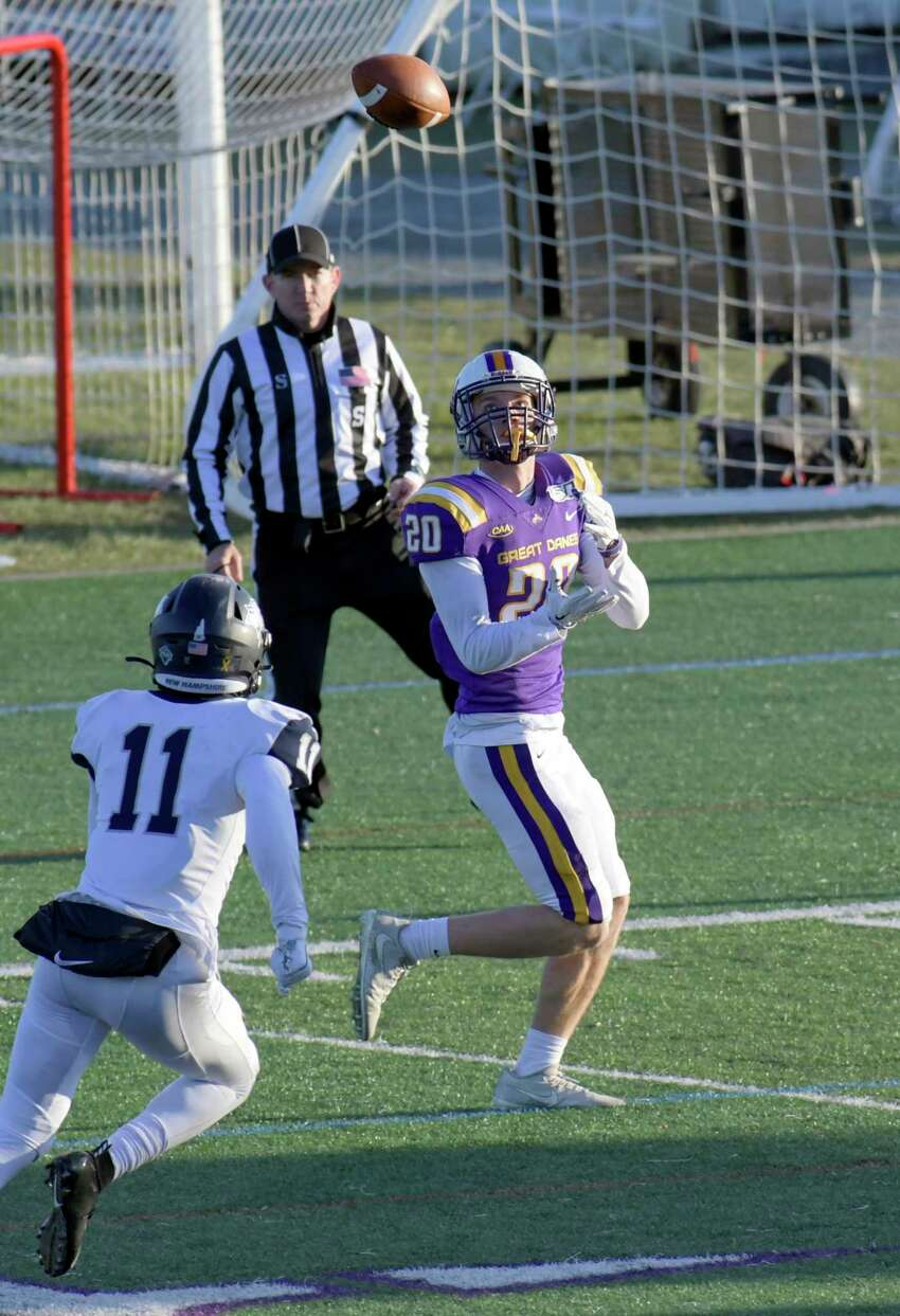 University at Albany wide receiver Tyler Oedekoven (20) catches a pass for a touchdown in front New Hampshire safety Max Oxendine (11) during the second half of an NCAA football game Saturday, Nov. 16, 2019, in Albany, N.Y. University at Albany won the game 24-17.