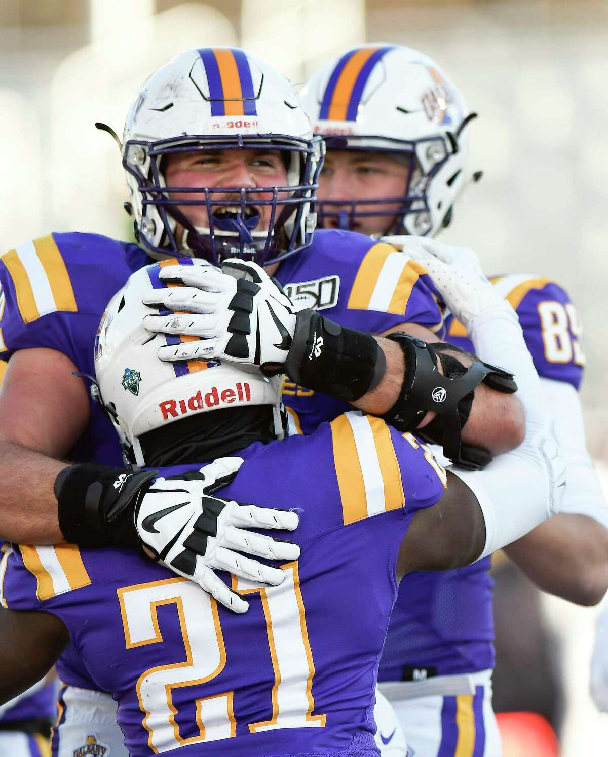 University at Albany running back Karl Mofor (21) celebrates his touchdown with teammate offensive lineman Griffin Clancy (72) during the first half of an NCAA football game against New Hampshire Saturday, Nov. 16, 2019, in Albany, N.Y. University at Albany won the game 24-17.