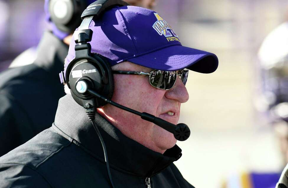 University at Albany head coach Greg Gattuso instructs his players against New Hampshire during the first half of an NCAA football game Saturday, Nov. 16, 2019, in Albany, N.Y. University at Albany won the game 24-17.