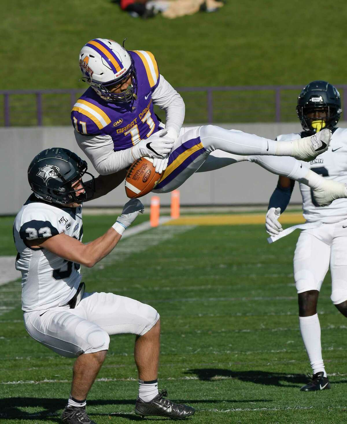 New Hampshire safety Evan Horn (33) breaks up a pass intended for University at Albany wide receiver Jerah Reeves (11) during the first half of an NCAA football game Saturday, Nov. 16, 2019, in Albany, N.Y. University at Albany won the game 24-17. (Hans Pennink)