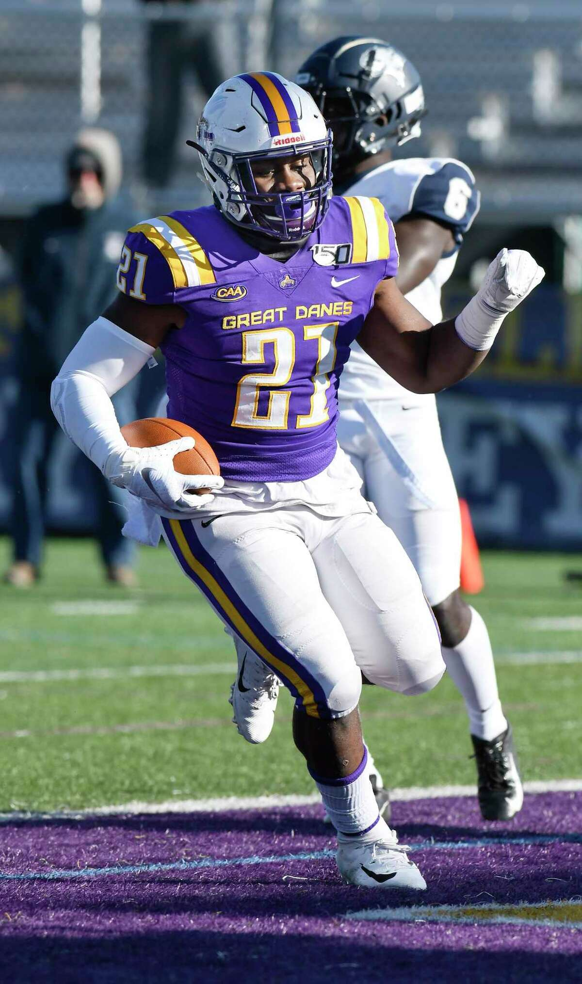 University at Albany running back Karl Mofor (21) scores a touchdown against New Hampshire during the first half of an NCAA football game Saturday, Nov. 16, 2019, in Albany, N.Y. University at Albany won the game 24-17.