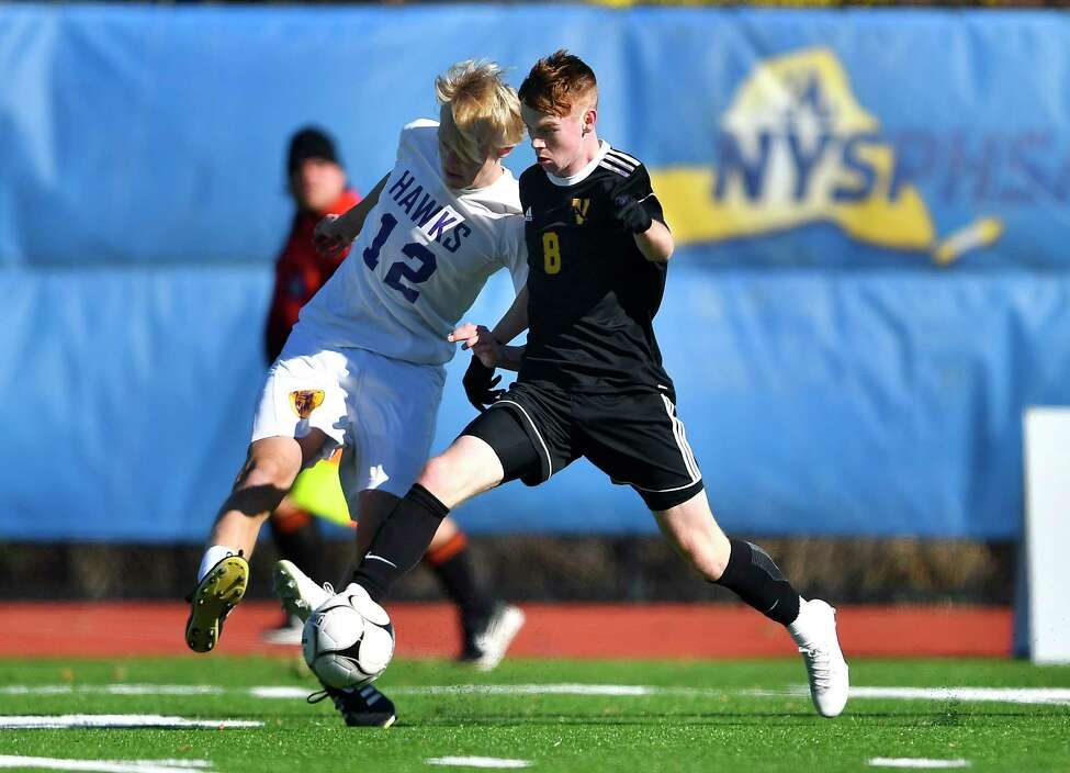 Voorheesville's Derek Moore, right, challenges for the ball against Rhinebeck's Andrew Gausepohl during a NYSPHSAA Boys Soccer Championships Class C semifinal in Middletown, N.Y., Saturday, Nov. 16, 2019. Voorheesville's season ended with a 1-0 loss to Rhinebeck-IX. (Adrian Kraus / Special to the Times Union)