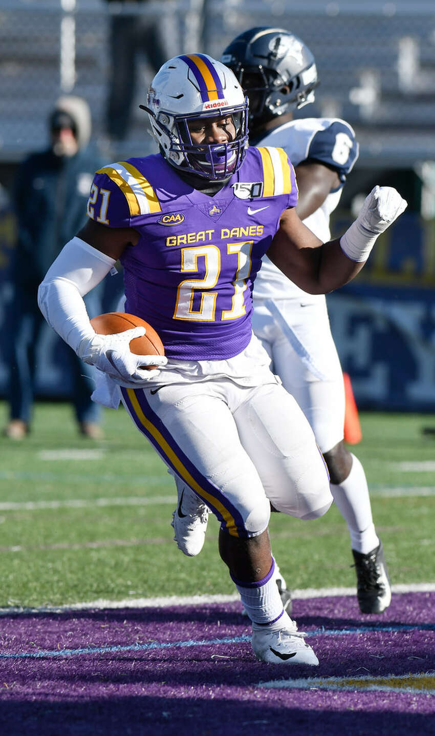 UAlbany's Karl Mofor runs for the first of his two touchdowns in the 24-17 win over New Hampshire on Nov. 16, 2019.