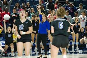 Friendswood celebrates a point against Manvel Saturday, Nov. 16 in the regional volleyball championship game at Delmar Fieldhouse.