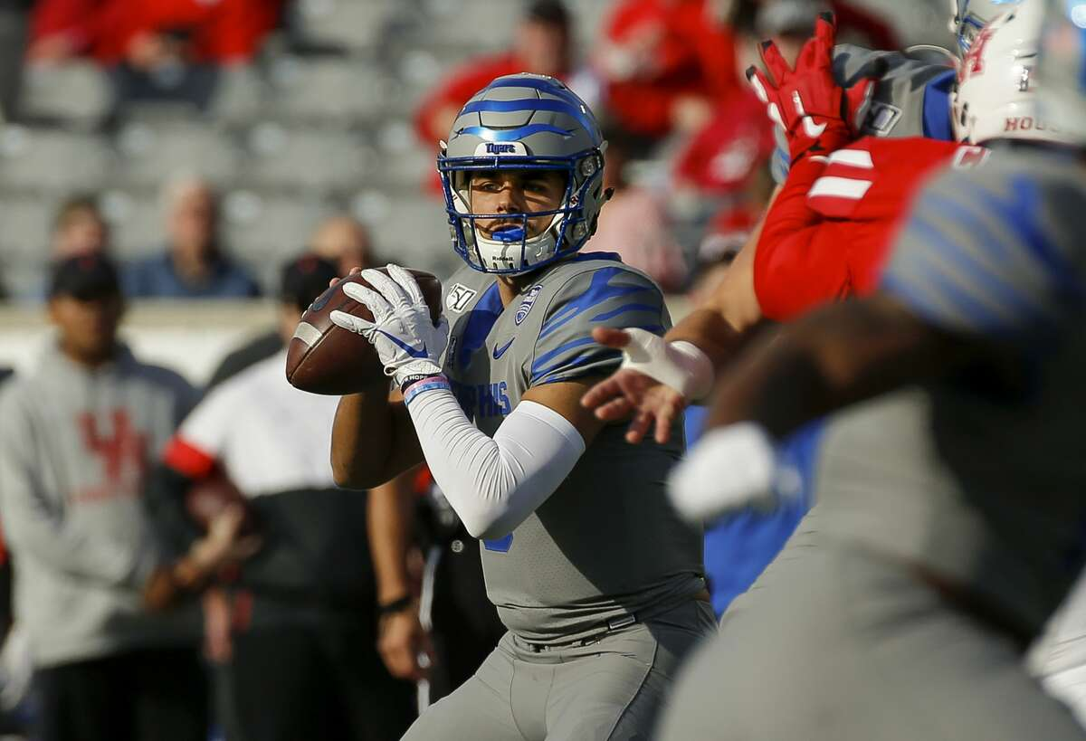 Memphis Tigers quarterback Brady White (3) looks for an open teammate against the Houston Cougars during the first quarter of an NCAA game at TDECU Stadium Saturday, Nov. 16, 2019, in Houston.