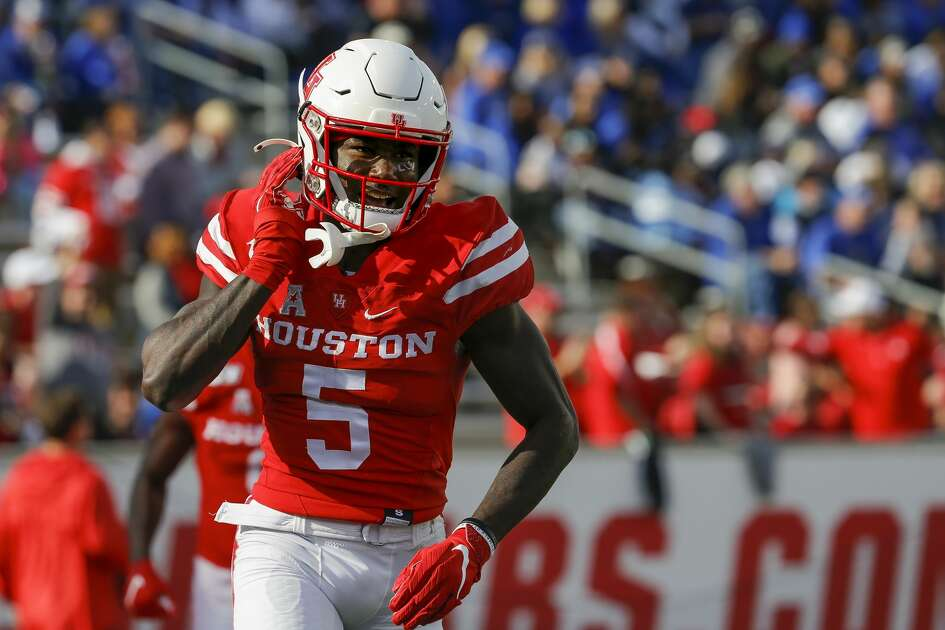 Houston Cougars wide receiver Marquez Stevenson (5) smiles after scoring a 53-yard touchdown against the Memphis Tigers during the first quarter of an NCAA game at TDECU Stadium Saturday, Nov. 16, 2019, in Houston.