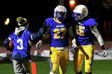 Queensbury's Zachary Cunningham (55) congratulates teammate Joe Slattery for his touchdown during the Class A state quarterfinal against Cornwall on Saturday, Nov. 16, 2019, at Shenendehowa High School in Clifton Park, N.Y. (Jenn March, Special to the Times Union )