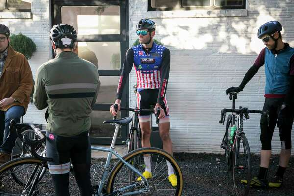 Former pro cyclist Phil Gaimon meets other cyclists for a morning group bike ride on Nov. 16, 2019, at the Bicycle Speed Shop in the Heights.