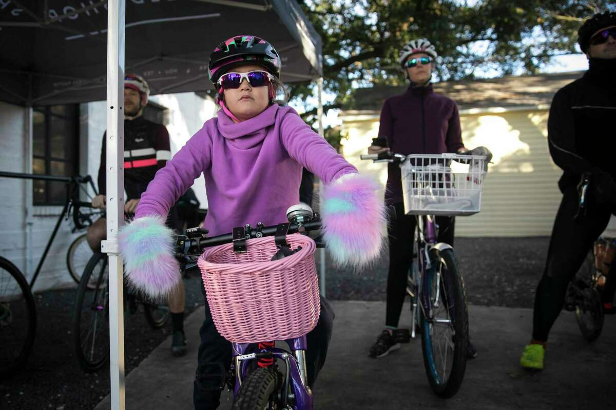 Fiona Humber, 6, waits for a morning group bike ride to begin from the Bicycle Speed Shop on Nov. 16, 2019, in the Heights.