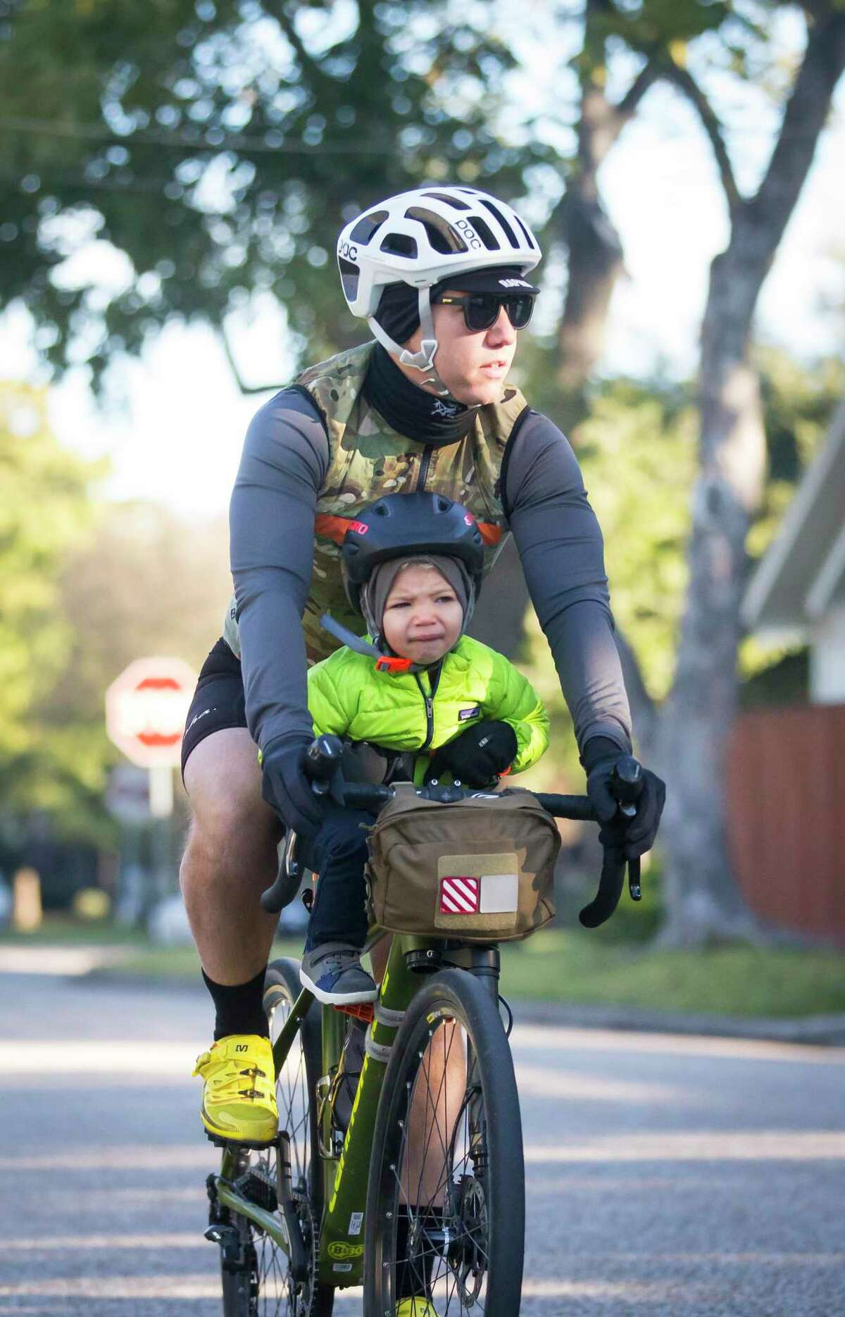 James Eilers rides with his 2.5-year-old son, Burton, during a morning group bike ride on Nov. 16, 2019, in the Heights. The family ride was organized by former pro cyclist Phil Gaimon and hosted by the Bicycle Speed Shop and Gaimon's sponsor, Integrated Informatics Inc.