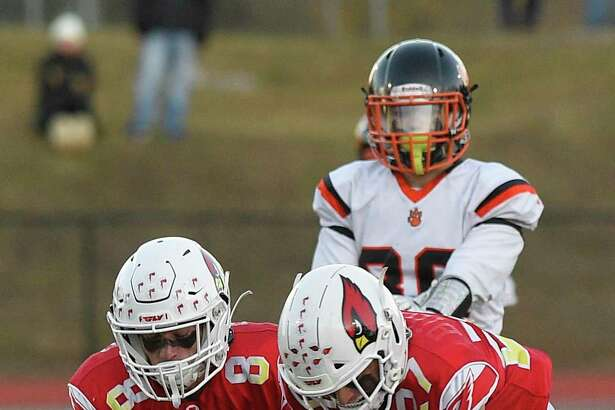 Greenwich defenders sack Ridgefield Kai Prohaszka in the first half in a high school football game at Cardinal Stadium on Nov. 16, 2019 in Greenwich, Connecticut.