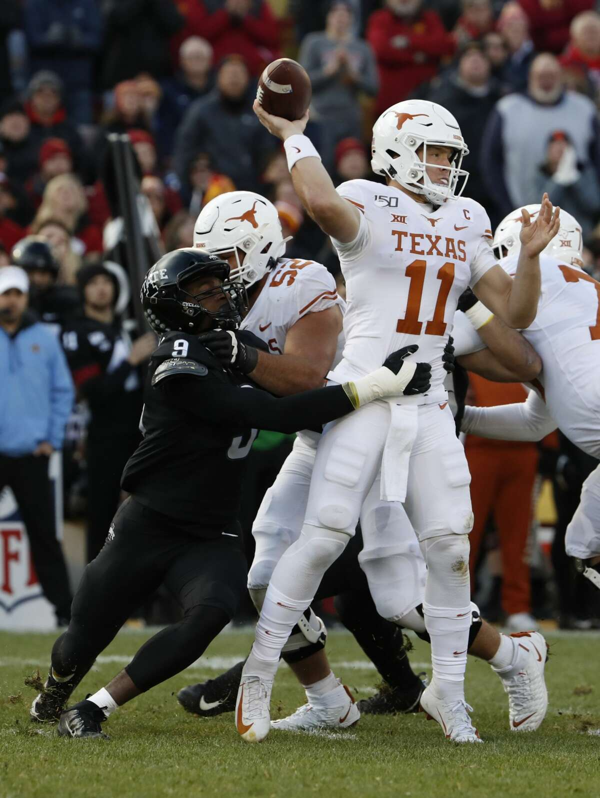AMES, IA - NOVEMBER 16: Linebacker Will McDonald #9 of the Iowa State Cyclones puts pressure on quarterback Sam Ehlinger #11 of the Texas Longhorns as offensive lineman Samuel Cosmi #52 of the Texas Longhorns blocks in the first half of play at Jack Trice Stadium on November 16, 2019 in Ames, Iowa. (Photo by David Purdy/Getty Images)