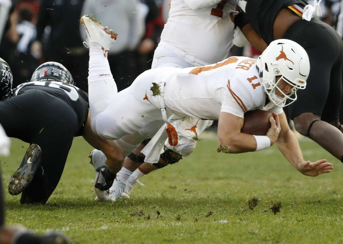 AMES, IA - NOVEMBER 16: Defensive end Zach Petersen #55 of the Iowa State Cyclones tackles quarterback Sam Ehlinger #11 of the Texas Longhorns as he scrambled for yards in the first half of play at Jack Trice Stadium on November 16, 2019 in Ames, Iowa. (Photo by David Purdy/Getty Images)