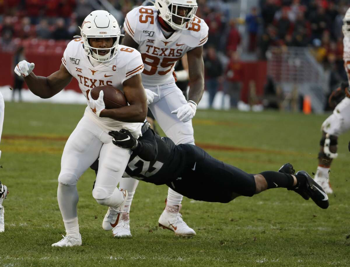 AMES, IA - NOVEMBER 16: Wide receiver Devin Duvernay #6 of the Texas Longhorns is tackled by defensive back Greg Eisworth #12 of the Iowa State Cyclones as he rushed for yards in the first half of play at Jack Trice Stadium on November 16, 2019 in Ames, Iowa. (Photo by David Purdy/Getty Images)