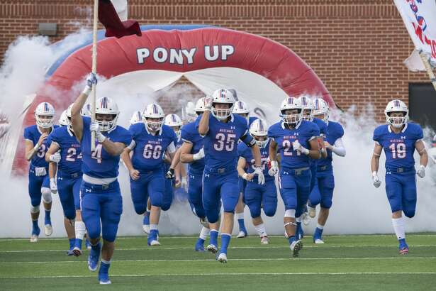 Midland Christian players take the field 11/16/19 for the TAPPS Division 1 bi-district playoff against Houston St. Piuys X at Gordon Awtry Field. Tim Fischer/Reporter-Telegram