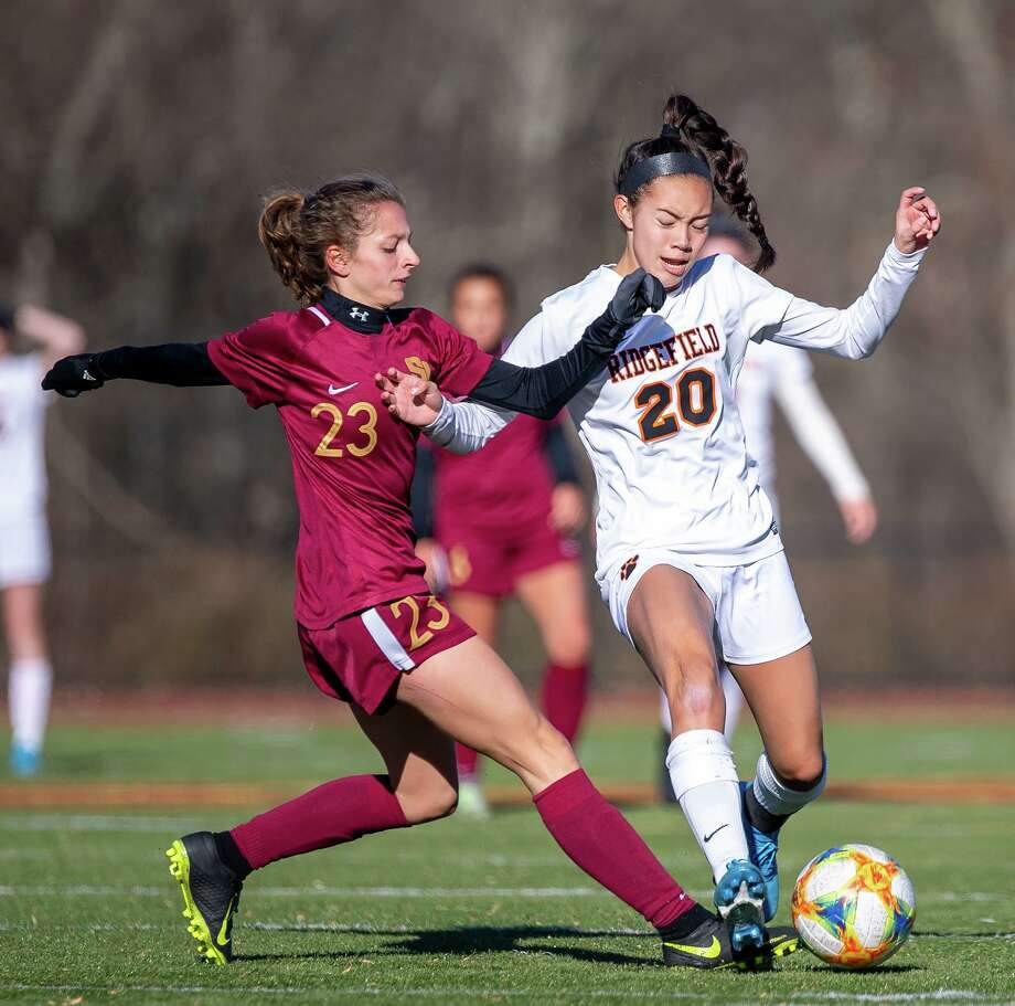 St. Joseph's Julia DiCesare and Ridgefield's Julia Bragg battle for possession. Ridgefield high defeated St. Joseph, 2-1, in the quarterfinals of the CIAC Class LL state girls soccer tournament Photo: David G Whitham / For Hearst Connecticut Media / DGWPhotography
