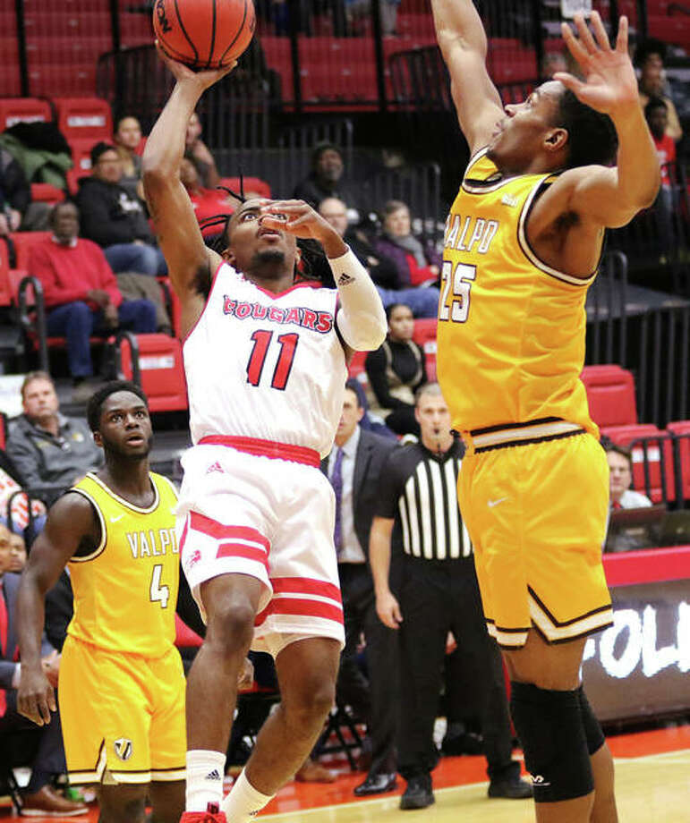 SIUE's Tyreese Williford (11) shoots over Valpo's Nick Robinson in Tuesday's game at First Community Arena in Edwardsville. The Cougars played at Incarnate Word on Saturday in San Antonio, Texas. Photo: Greg Shashack / The Telegraph